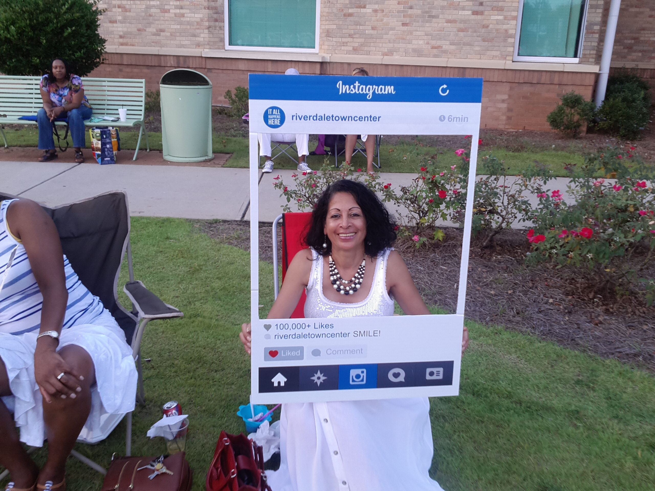 Woman Sitting in Lawn Chair with Instagram Cut Out