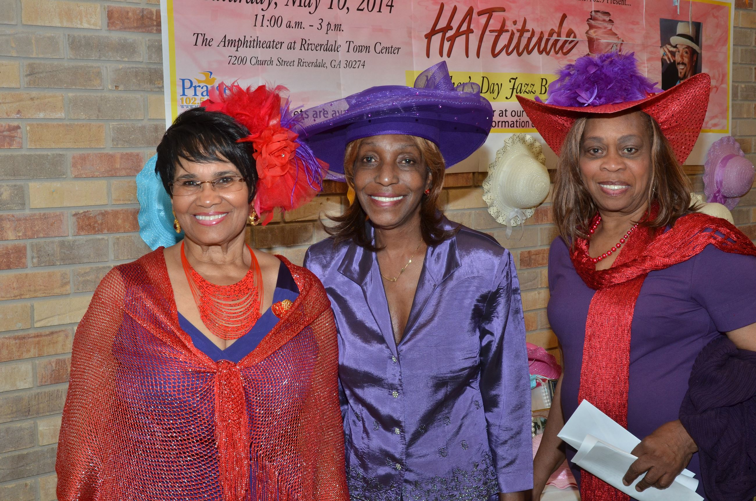 Women in Red and Purple Hats and Clothes