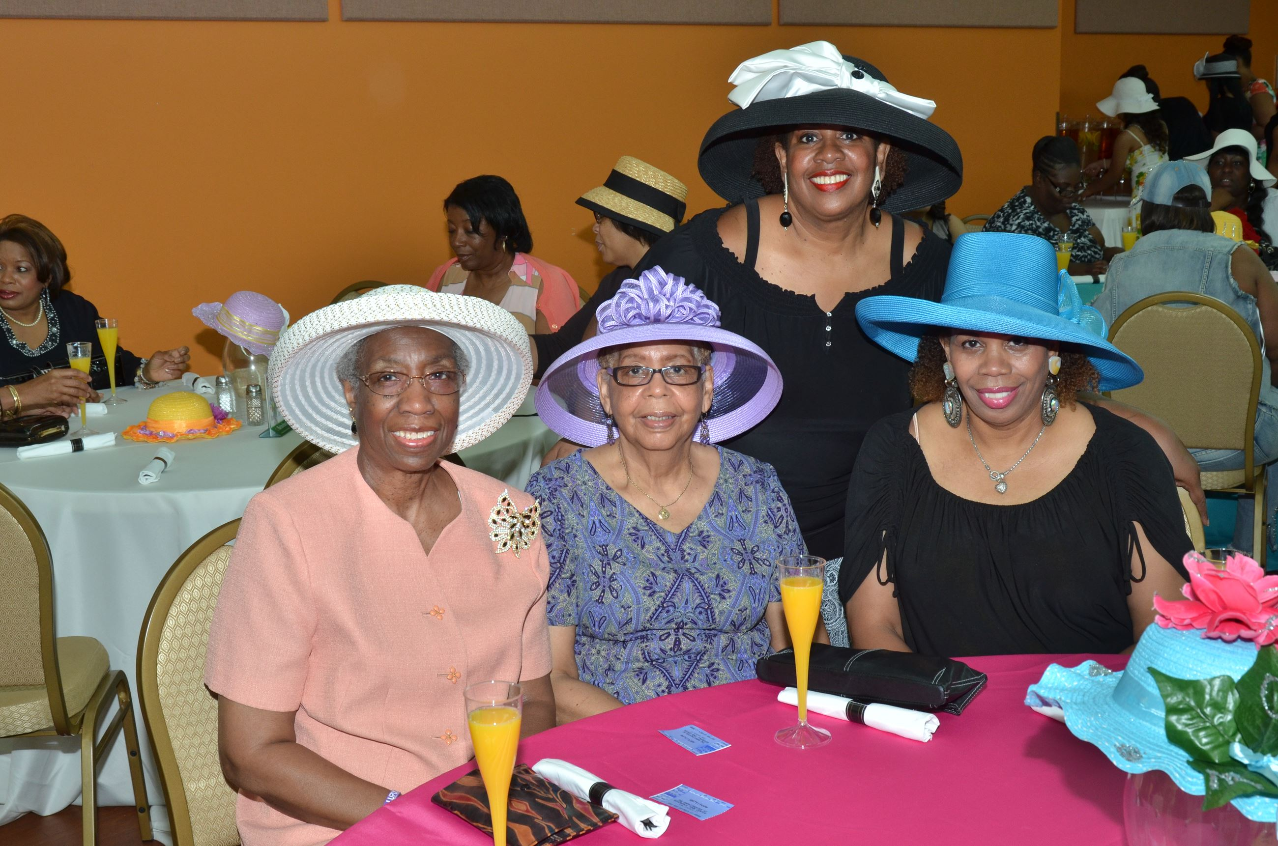 Women in White, Purple, Blue and Black Hats