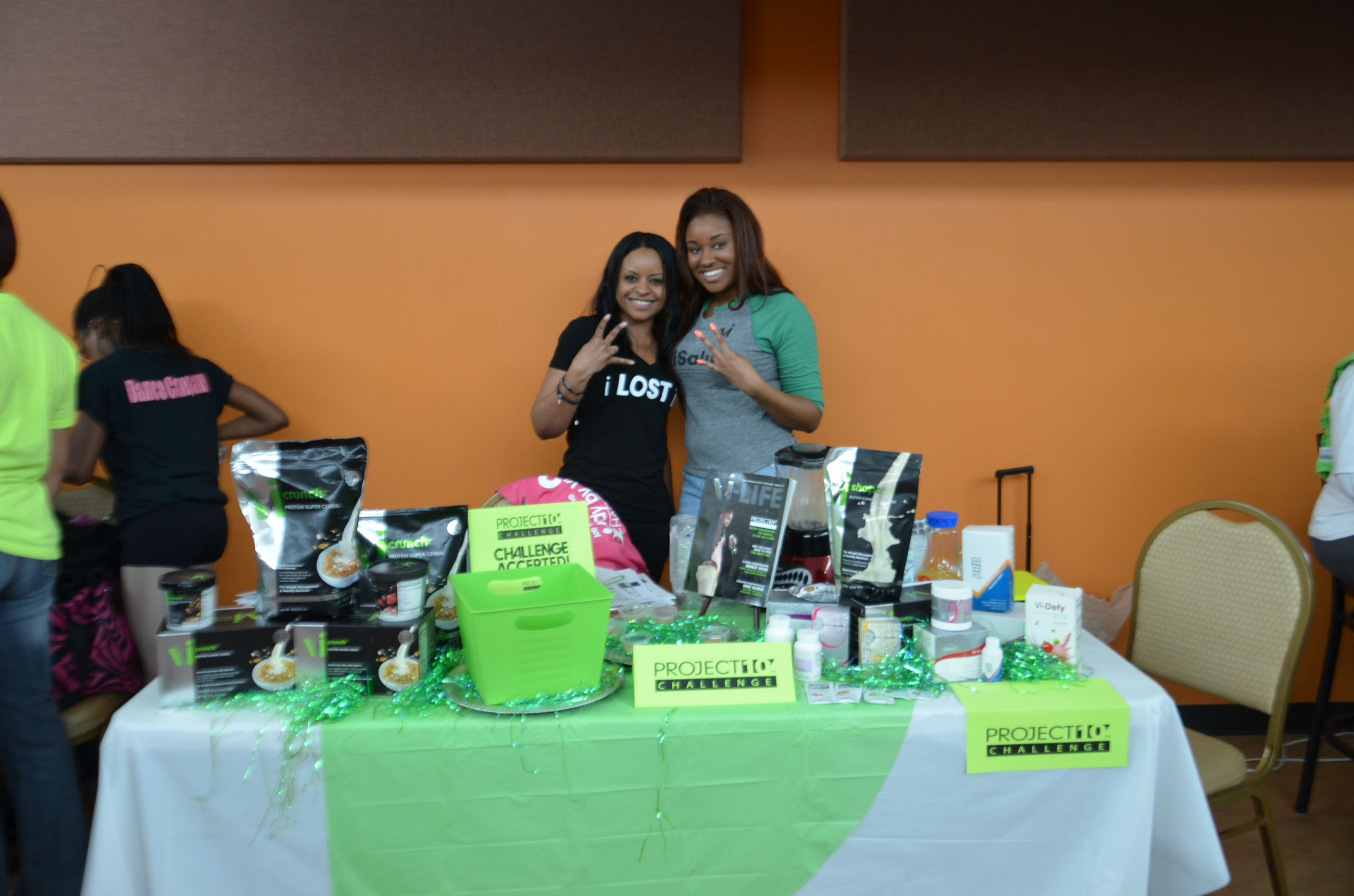 Women Standing Behind Protection Challenge Table